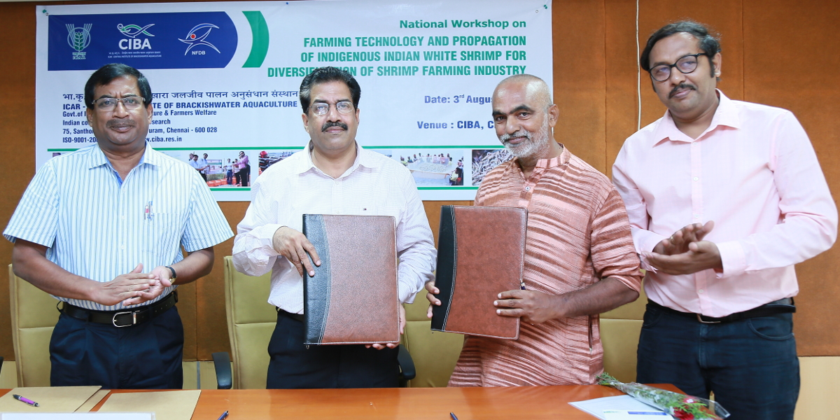 Dr K.K. Vijayan Director CIBA exchanging the MoU document with the stakeholder during the National Workshop on Indian White Shrimp Farming on 3rd Aug, 17
